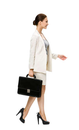 Profile of walking businesswoman with case, isolated on white. Concept of leadership and success