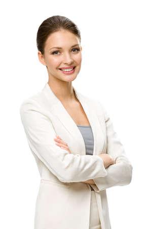 mani incrociate: Mezza lunghezza ritratto di donna d'affari con le mani incrociate, isolato su uno sfondo bianco. Concetto di leadership e di successo