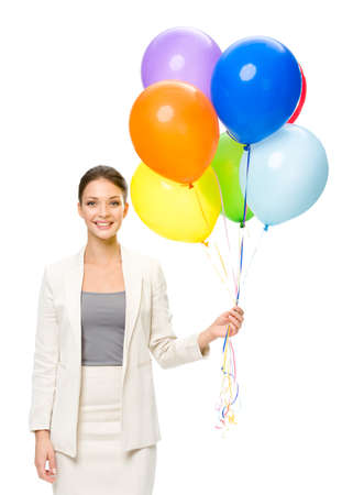 Portrait of business woman keeping colorful balloons, isolated. Concept of holiday and fun photo