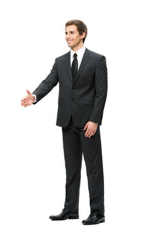 Full-length portrait of businessman handshake gesturing, isolated on white. Concept of leadership and cooperation photo