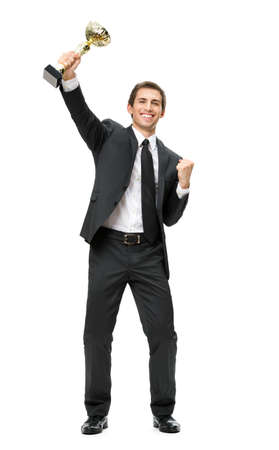 Full-length portrait of gesturing fists up businessman with gold cup, isolated on white. Concept of win and success photo