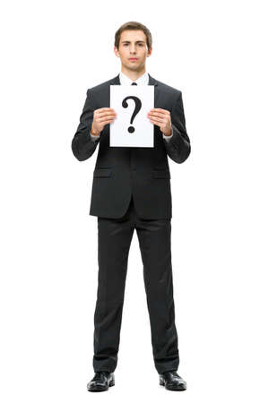 Full-length portrait of business man handing question mark, isolated on white. Concept of problem and solution photo