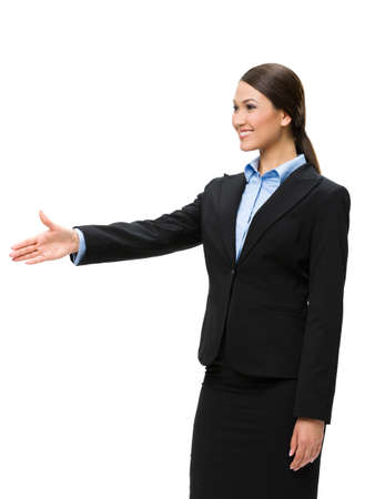 Half-length portrait of businesswoman handshake gesturing, isolated on white. Concept of leadership and cooperation photo