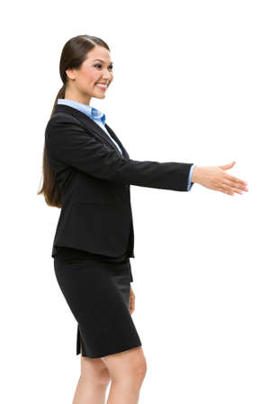 Half-length profile of business woman handshake gesturing, isolated on white. Concept of leadership and cooperation photo