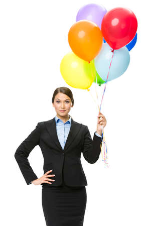 Portrait of businesswoman keeping colorful balloons, isolated. Concept of holiday and fun photo
