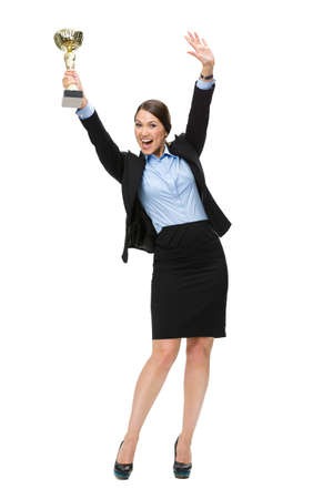award winning: Full-length portrait of businesswoman handing gold cup up, isolated on white. Concept of victory and success