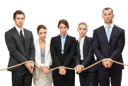servitude: Hands of group of business people are tied with rope, isolated on white. Concept of routine work and slavery