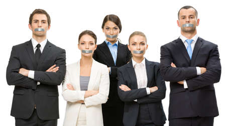 Group of business people with taped mouths and their hands crossed, isolated on white. Concept of slavery and routine work photo