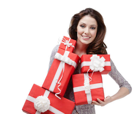unexpected: Pretty woman hands a great amount of red gift boxes, isolated on white