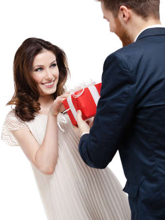 make a gift: Man wonders his girlfriend with International Womans Day present, isolated on white