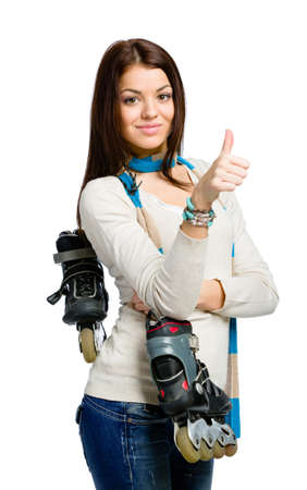Half-length portrait of teenager handing roller skates and wearing colored scarf who thumbs up, isolated on white Stock Photo - 22746768