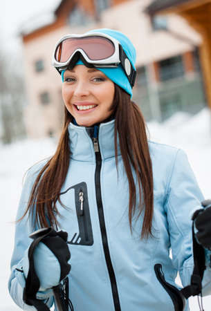 Portrait of female alps skier. Concept of snow sport and healthy lifestyle photo