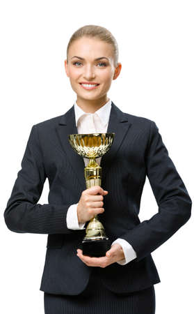 Half-length portrait of businesswoman keeping golden cup, isolated on white. Concept of victory and success photo