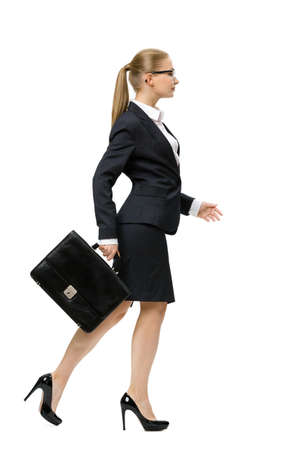 sideview: Profile of walking businesswoman handing case, isolated on white. Concept of leadership and success