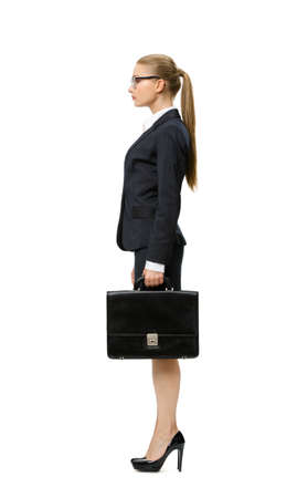 suit case: Profile of businesswoman handing case, isolated on white. Concept of leadership and success Stock Photo