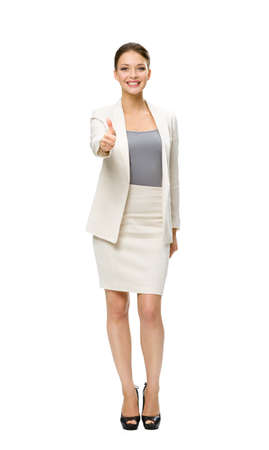 Full-length portrait of businesswoman who thumbs up, isolated on white. Concept of leadership and success