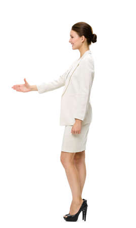 Full-length profile of business woman handshaking, isolated on white. Concept of leadership and success photo