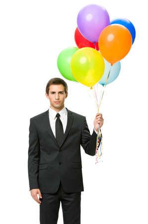 congratulate: Half-length portrait of business man handing colorful balloons, isolated on white. Concept of holiday and congratulation Stock Photo