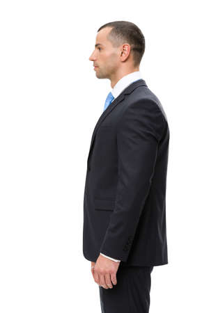 sideview: Half-length profile of business man, isolated on white. Concept of leadership and success