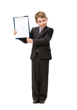 Full-length portrait of little manager showing folder, isolated on white. Concept of leadership and success photo