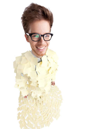 Wide angle shot of young man covered with yellow sticky notes, isolated on white photo