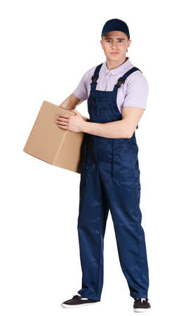 workmen: Workman in overalls and blue peaked cap hands a cardboard box, isolated on white. Transportation service Stock Photo