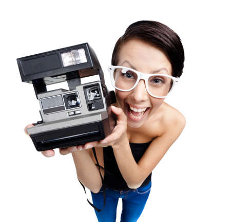 Smiley woman with cassette photographic camera, isolated on white, wide angle photo