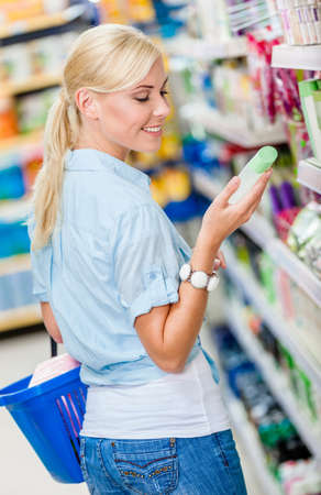 Girl at the store choosing cosmetics among the great variety of products. Concept of consumerism, retail and purchase photo