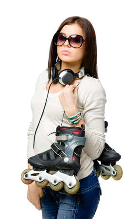 Half-length portrait of teenager handing roller skates and wearing sunglasses and earphones, isolated on white Stock Photo - 22809166