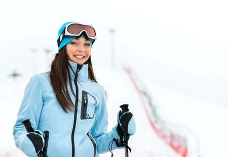 Portrait of female downhill skier. Concept of snow sport and healthy lifestyle photo