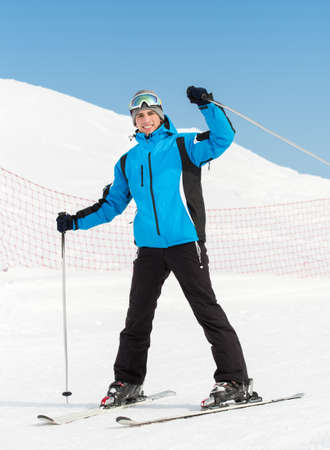 Full-length portrait of male skier. Concept of extreme winter sports photo