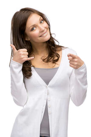 adult intercourse: Half-length portrait of woman cell phone gesturing who points with finger at you, isolated on white. Concept of communication and contact Stock Photo