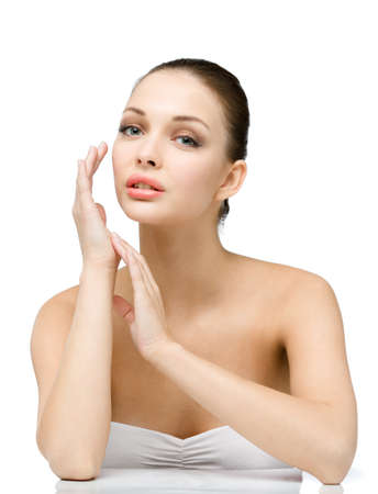 flawless: Portrait of female touching her face, isolated on white. Concept of natural beauty and perfect skin
