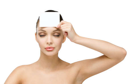 girl with eyes closed hands white and blank copyspace card in front of her forehead, isolated on white photo