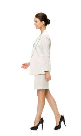 side job: Full-length profile of walking businesswoman, isolated. Concept of leadership and success