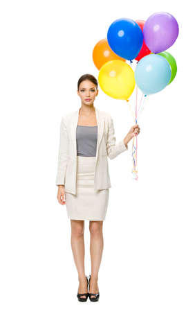 Full-length portrait of businesswoman keeping colorful balloons, isolated on white. Concept of leadership and success photo