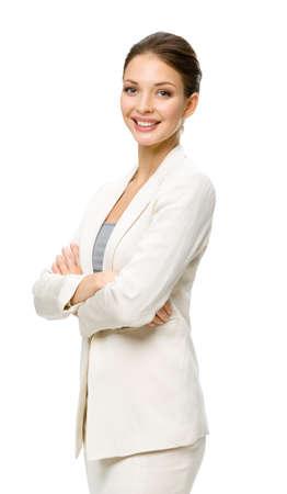 mani incrociate: Mezza lunghezza ritratto di imprenditrice con le mani incrociate, isolato su un bianco. Concetto di leadership e di successo Archivio Fotografico