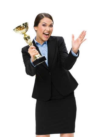 Half-length portrait of businesswoman with gold cup, isolated on white. Concept of win and success photo