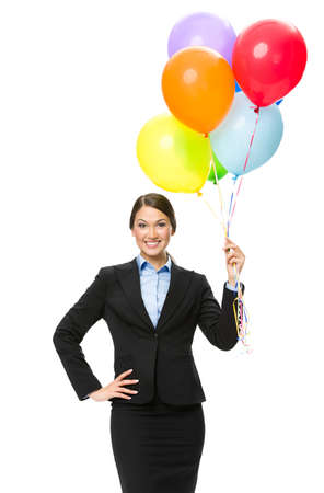 Portrait of business woman keeping colorful balloons, isolated on white. Concept of holiday and fun photo