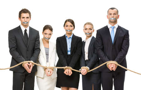 servitude: Group of business people tied with rope and their mouths are taped , isolated on white. Concept of routine work and slavery