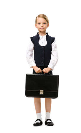 Full-length portrait of little businesswoman handing case, isolated on white. Concept of leadership and success photo