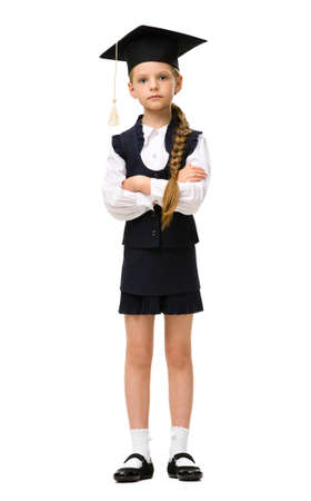 Full-length portrait of little student in academic cap, isolated. Concept of graduation and study photo