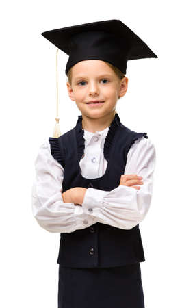 Half-length portrait of little student in academic cap with hands crossed, isolated on white. Concept of graduation and study photo