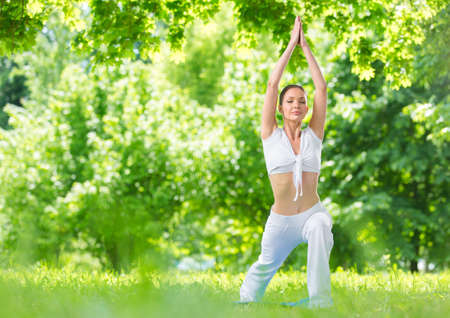 Full-length portrait of athlete exercising in park. Concept of healthy lifestyle and fitness Stock Photo