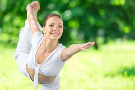 keep fit: Portrait of sportswoman exercising in park. Concept of healthy lifestyle and fitness