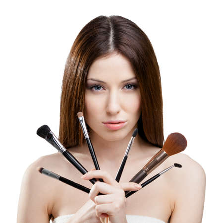 Woman handing a set of cosmetic brushes for make up, isolated on white photo