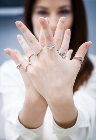 Close up of female hands with rings. Concept of wealth and luxurious life Stock Photo - 23372012