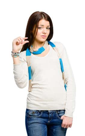 gestos: Adolescente que muestra una peque�a cantidad de algo, aislado en blanco Foto de archivo