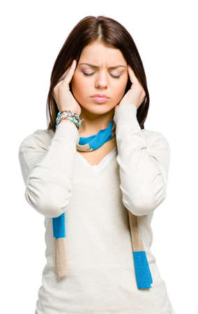 unsolvable: Teenager puts hands on head because of headache or unsolvable problems, isolated on white