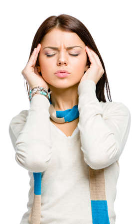 unsolvable: Teen with eyes closed puts hands on head because of headache or unsolvable problems, isolated on white